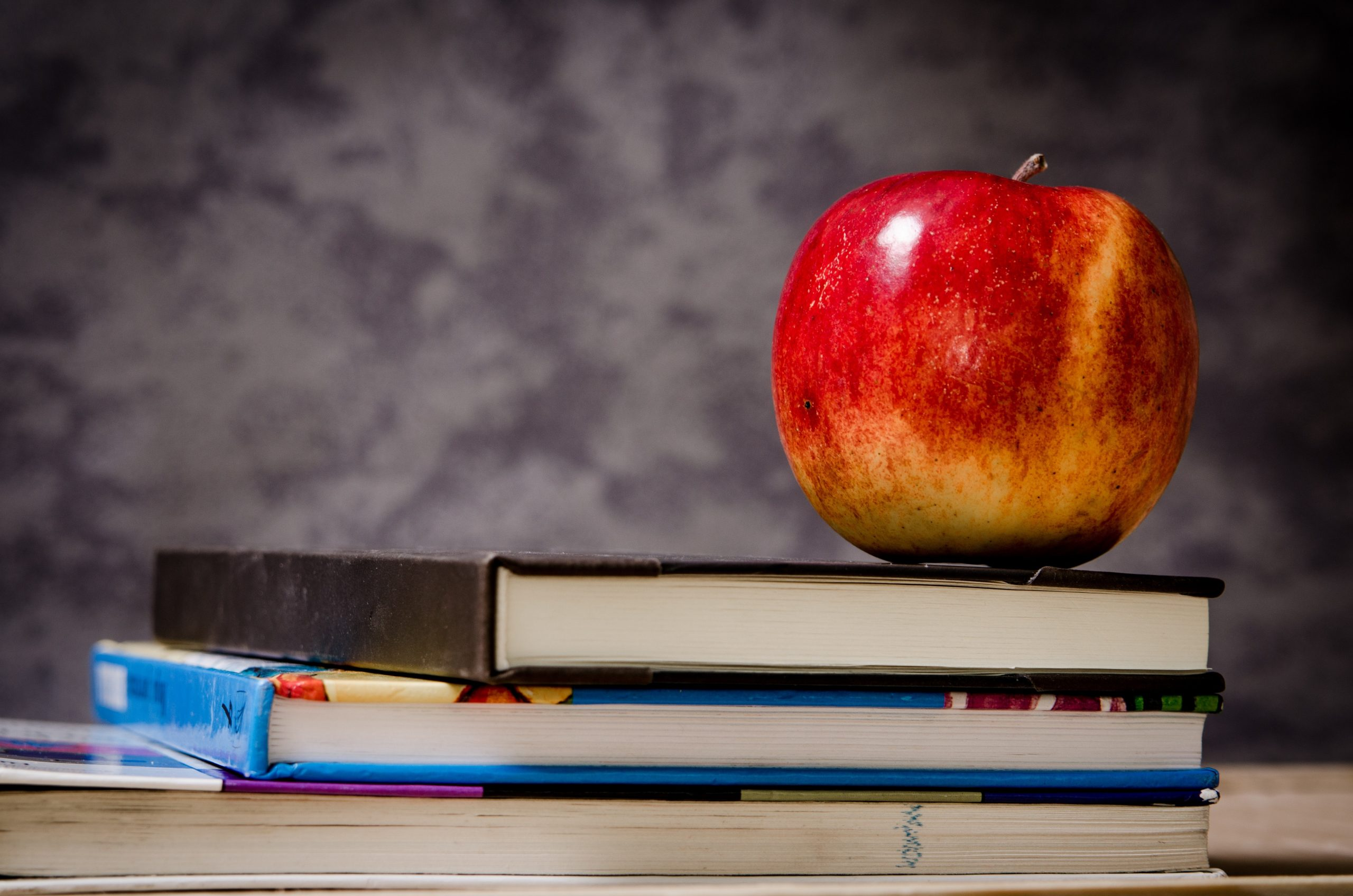 close-up-of-apple-on-top-of-books